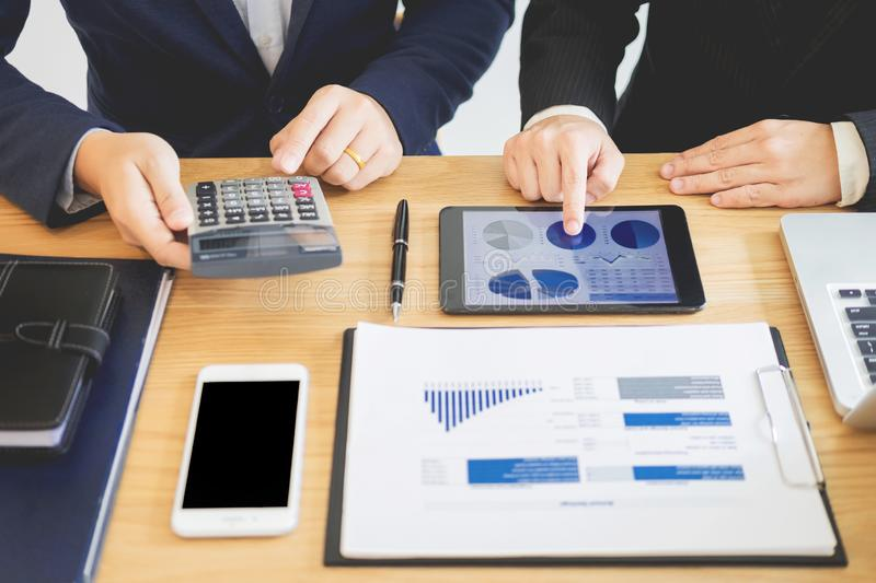 Team work business working discussing a new financial plan with startup project with calculator. in office calculating analyse. Profit graph plan royalty free stock photo