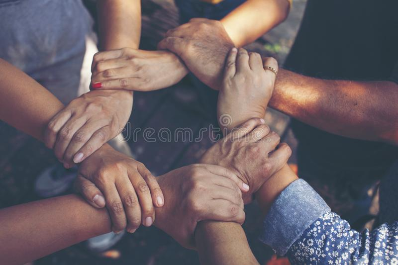 Team Work Concept : Group of Diverse Hands Together Cross Processing of young people in the nature royalty free stock photography