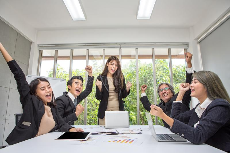 Team work of happy business people cheering in office. Celebrate success. Business team celebrate a good job in the office. Asian stock photography