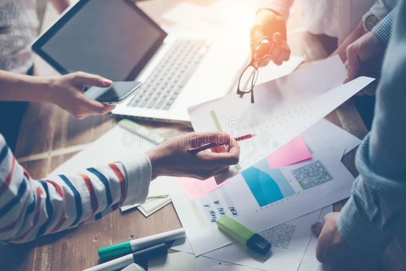 Team work process. New marketing plan discussing. Digital and paperwork stock photos