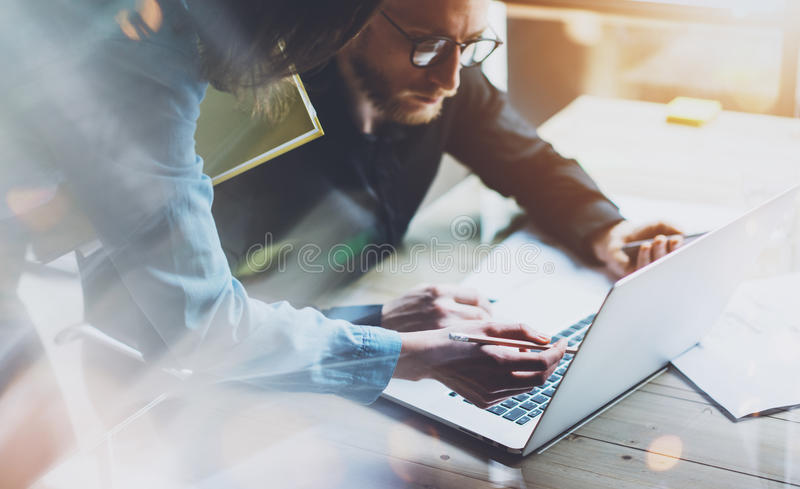 Team work process. Photo young business crew working with new startup project laptop. Project managers meeting. Analyze royalty free stock photos