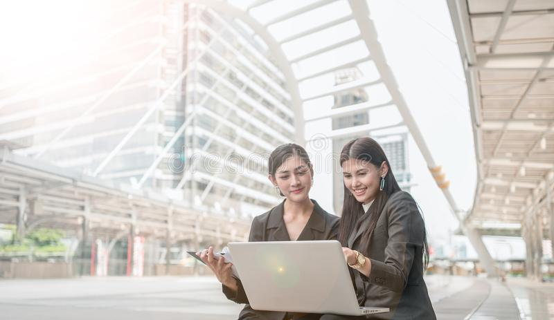 Team work process. Two business women with laptop in city. royalty free stock photo