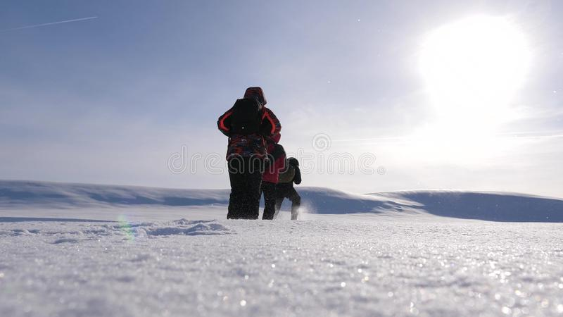 Team work and victory. three alpinist tourists follow each other in the snowy desert. team of business people go to. Team work and victory. three alpinist royalty free stock photography