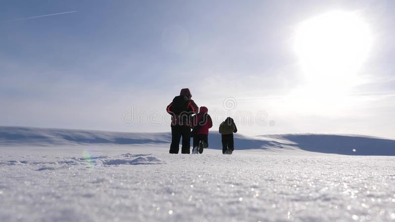 Team work and victory. three alpinist tourists follow each other in the snowy desert. team of business people go to. Team work and victory. three alpinist royalty free stock images