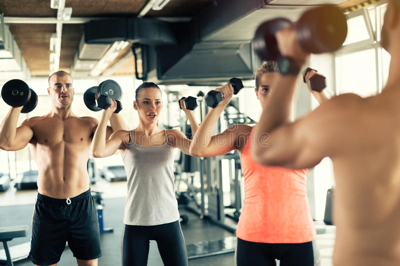 Team workout in gym royalty free stock images