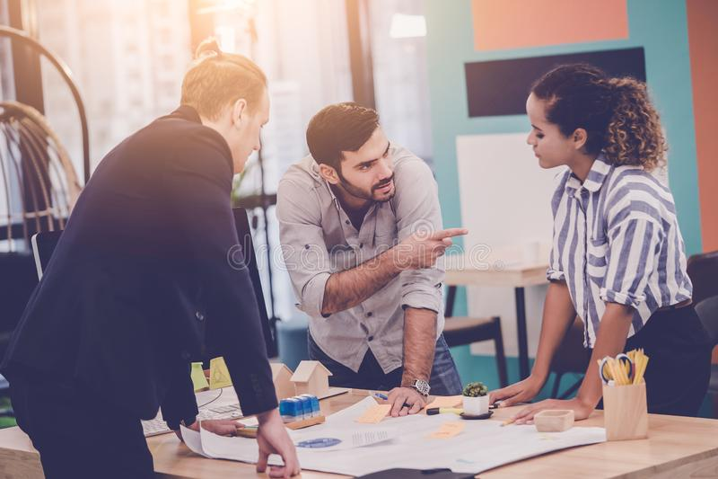 Team of Architect Designer is brainstorming in office for modern business start up teamwork connection concept stock photos