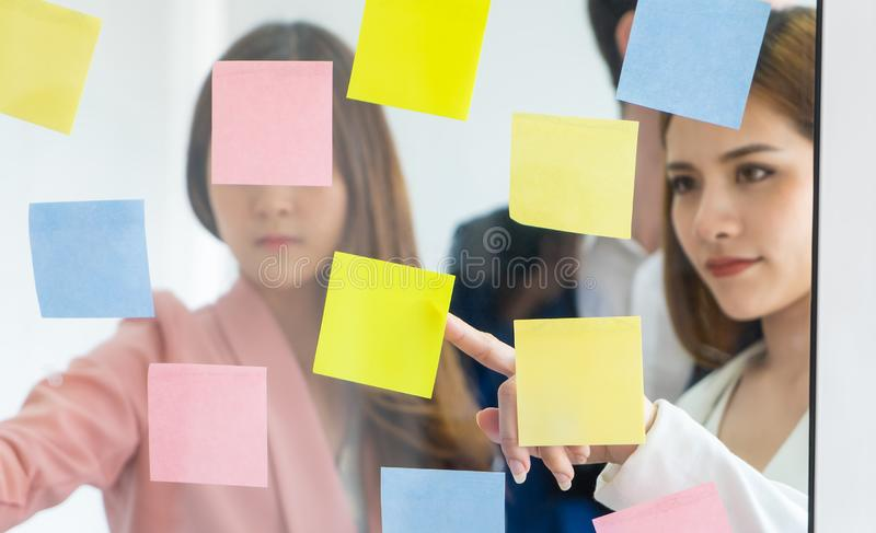 Team of young business man and woman standing in meetin room win royalty free stock photography