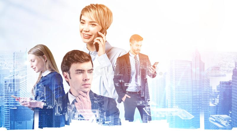 Team of young business people with smartphones stock images