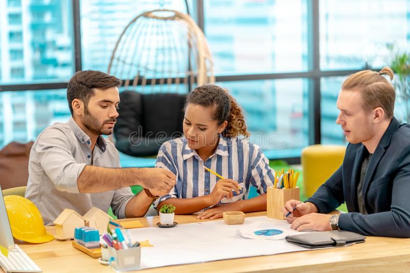 Team of young Business starter brainstroming in a co working space stock image