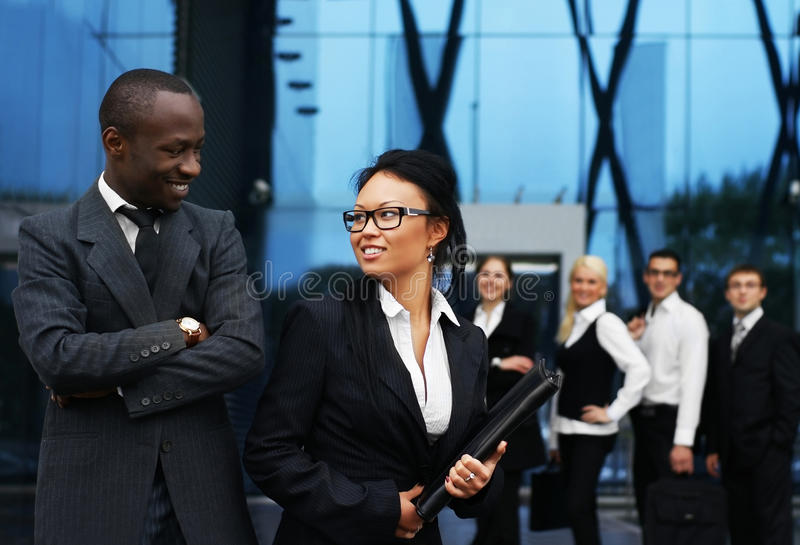 A team of young businesspeople in formal clothes royalty free stock images