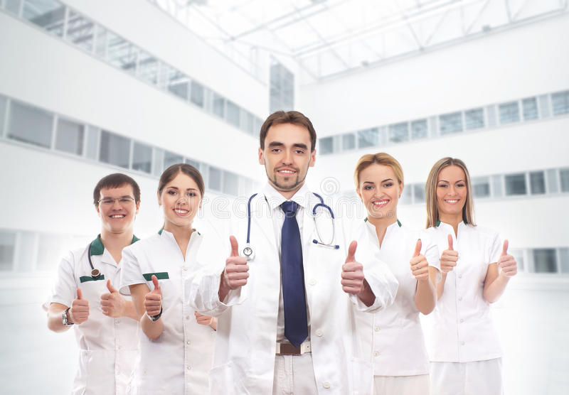A team of young Caucasian doctors in white clothes royalty free stock photography