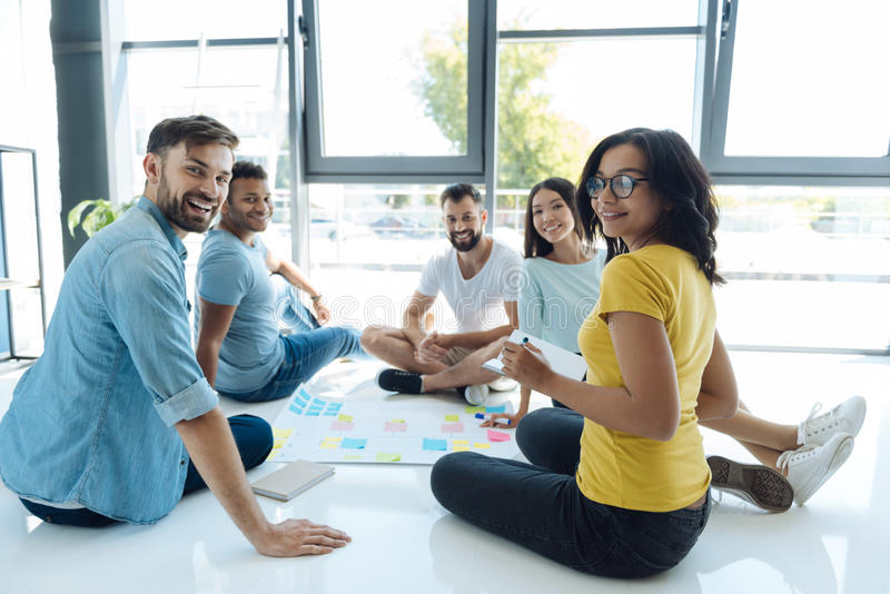Team of young creative people looking at you royalty free stock image