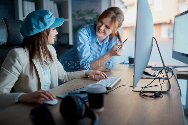 Team of employees is discussing the project and working overtim royalty free stock photography