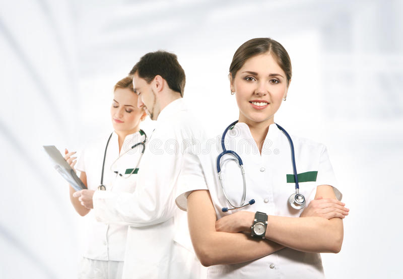 A team of young medical workers in white clothes royalty free stock photography
