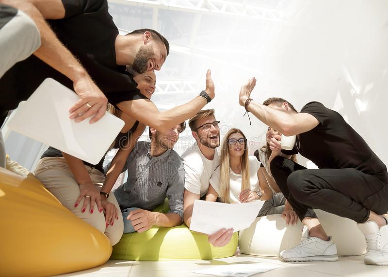 Team of young people giving a high five stock photos