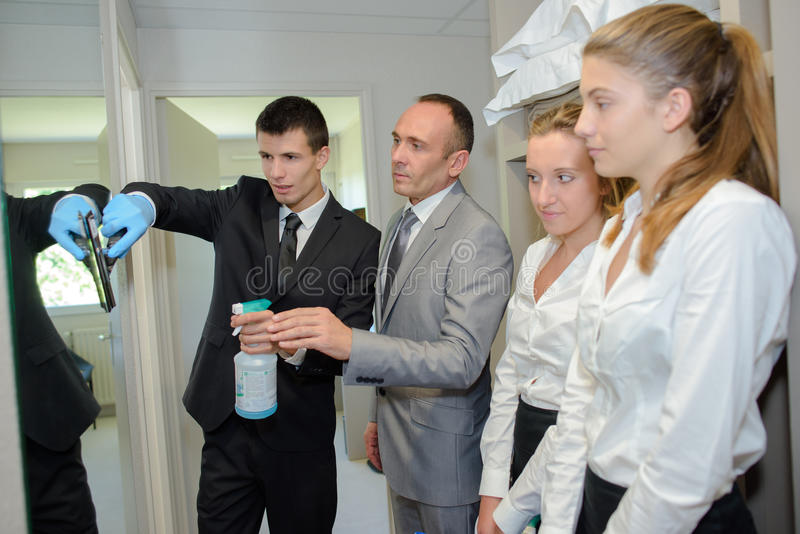 Team young people learning housekeeping stock images