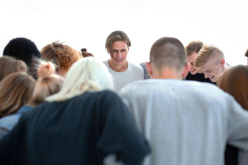 Team of young people makes a decision standing in a circle. Close up. a team of young people makes a decision standing in a circle royalty free stock image