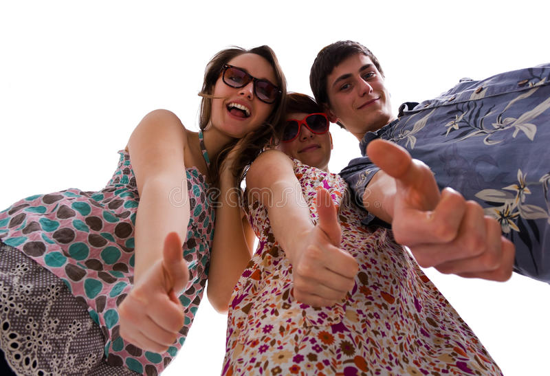 Team of young people showing thumbs up stock photo
