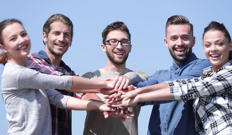 Team of young people shows their unity. royalty free stock images