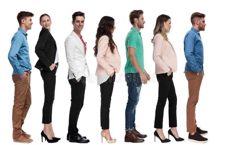 Team of young people standing in line royalty free stock images