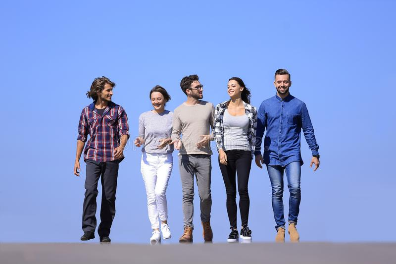 Team of young people walking along the road.outdoors royalty free stock photo