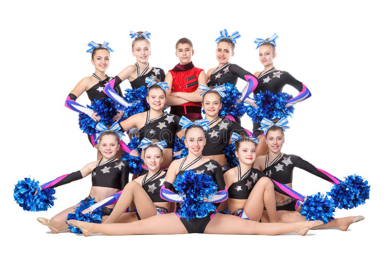 Team of young professional cheerleaders posing in the studio for a group photo. Dneprodzerzhinsk, Ukraine - February 13, 2016: team of young professional stock photography