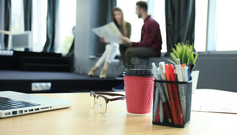 Team young professionals having casual discussion in office. Executives having friendly discussion during break. royalty free stock image