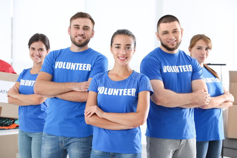 Team of young volunteers indoors royalty free stock photography