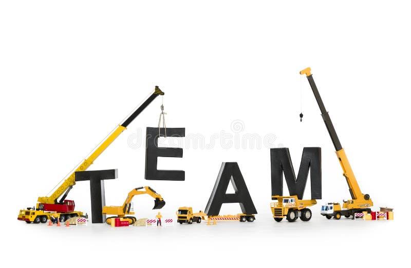 Teamentwicklung: Maschinen, die Teamwort aufbauen. stockfotos