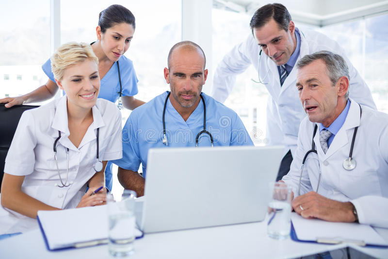 Teams Of Doctors Working On Laptop Computer Stock Photo - Image of ...