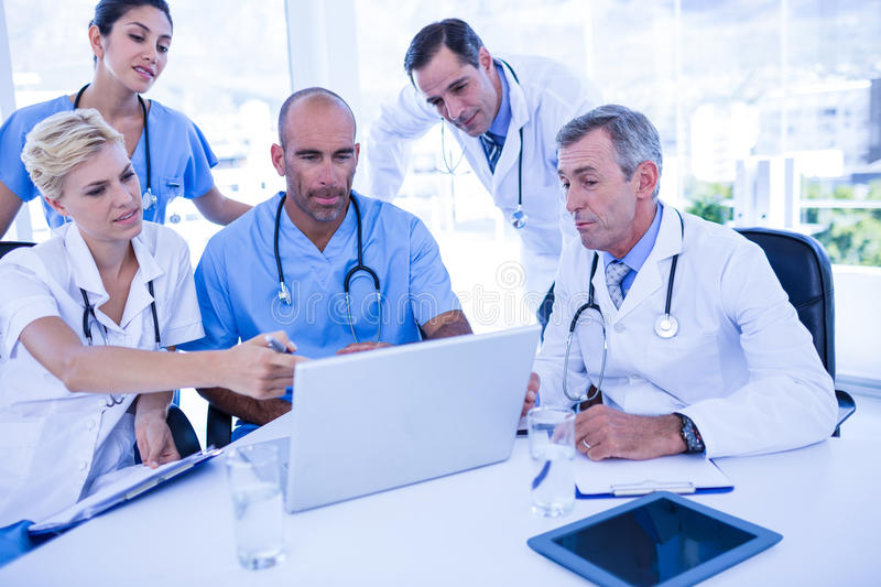 Teams Of Doctors Working On Laptop Computer Stock Image - Image of ...