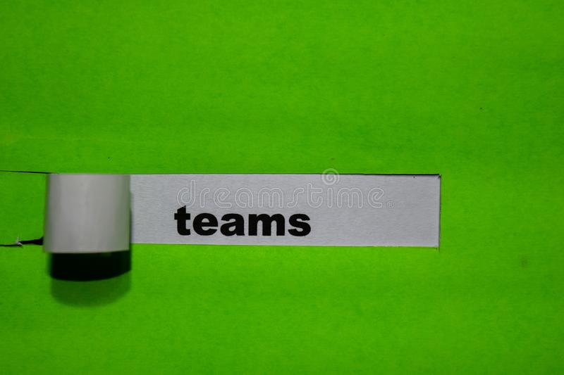 Teams, Inspiration and business concept on green torn paper royalty free stock photo