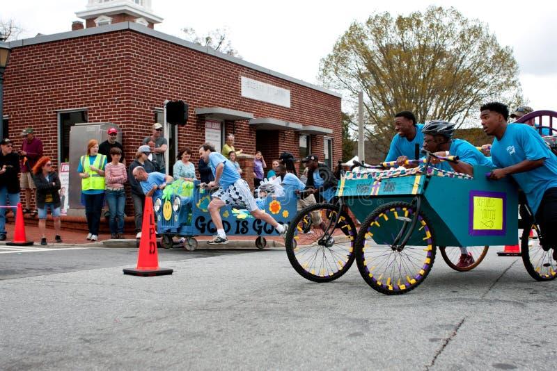 Teams Push Beds Around Corner In Unique Race Fundraiser stock photos