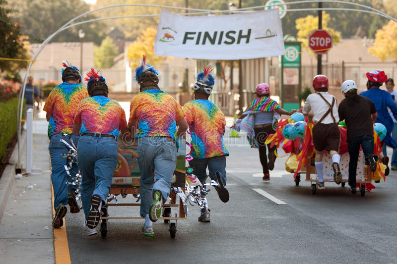 Download Teams Push Beds Toward Finish Of Mattress Race Editorial Image - Image of pavement, whimsical: 27875285