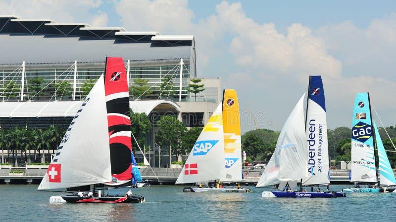 Download Teams Racing At Extreme Sailing Series Singapore 2013 Editorial Stock Image - Image: 30410744