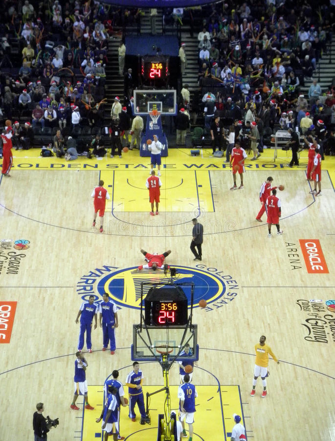 Teams warm-up at half time by taking shoots royalty free stock photography