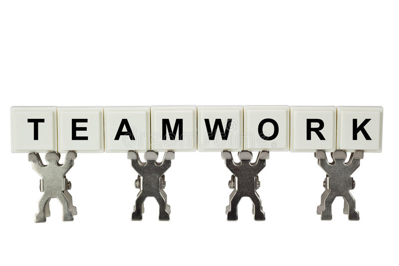 Teamwork. Figurines with teamwork isolated on white background royalty free stock photo