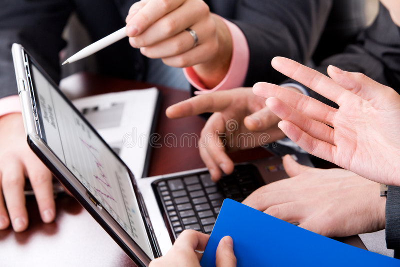 Teamwork. Photo of human hands pointing at monitor of laptop
