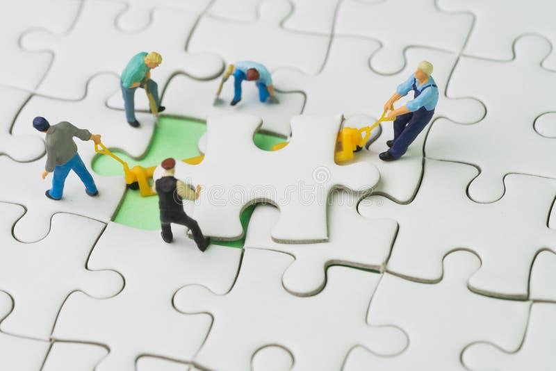 Teamwork arbete som laget för begrepp för affärsframgång, miniatyr w royaltyfria foton