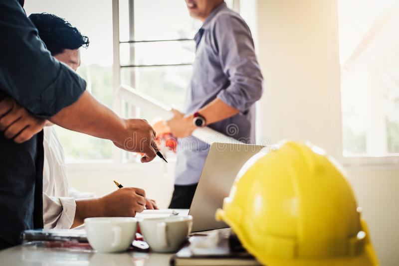 Teamwork of architect business people group working meeting in the office building plan design project. Construction engineering royalty free stock photo