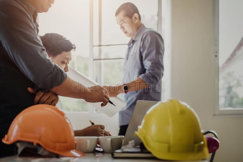 Teamwork of architect business people group working meeting in the office building plan design project. Construction engineering stock photos