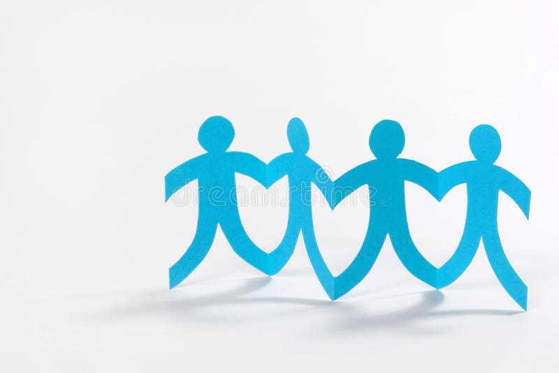 Teamwork, blue paper people on white stock illustration