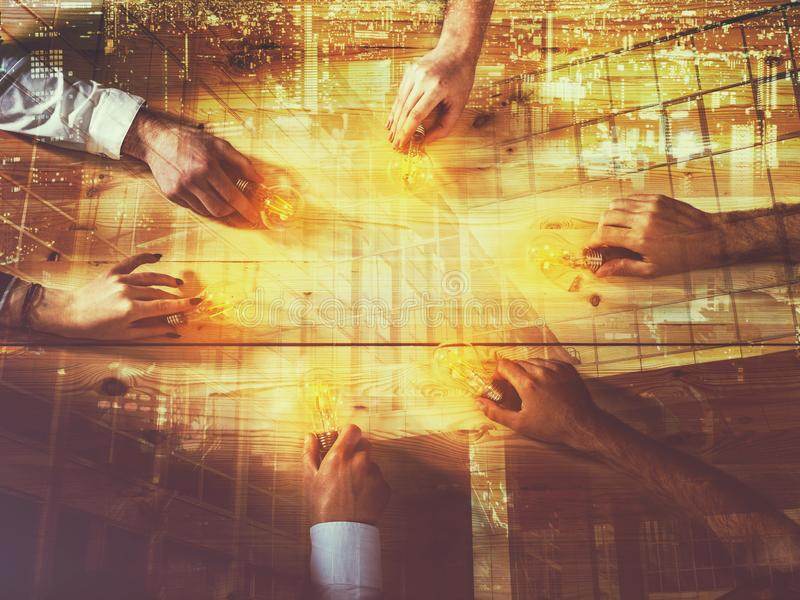Teamwork and brainstorming concept with businessmen that share an idea with a lamp. Concept company startup. Double. Agreement between business people with light stock illustration