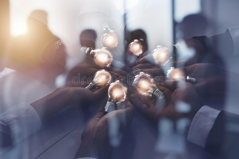 Teamwork and brainstorming concept with businessmen that share an idea with a lamp. Concept of startup. Double exposure. Teamwork and brainstorming concept with royalty free illustration