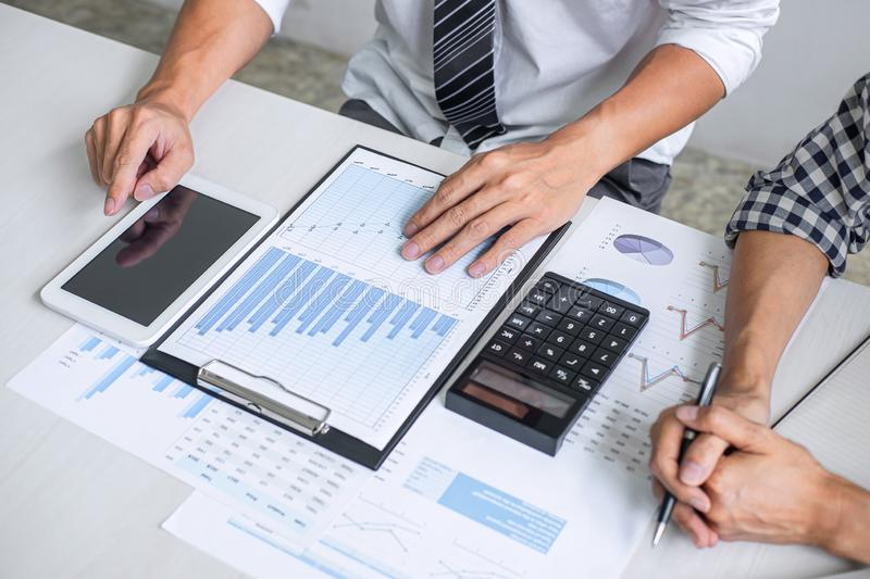 Teamwork of business casual colleagues, consultation new strategy plan business and market growth on financial document graph royalty free stock images