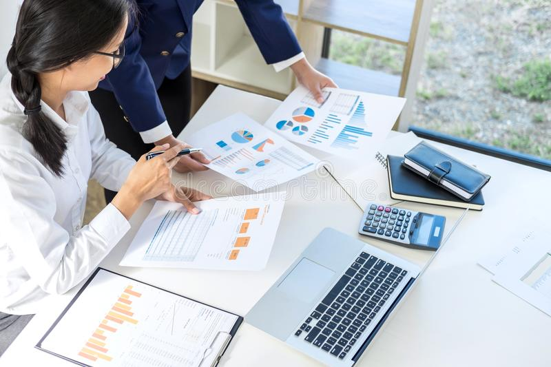 Teamwork of business colleagues consultation market growth on financial document graph report, professional occupation working royalty free stock images