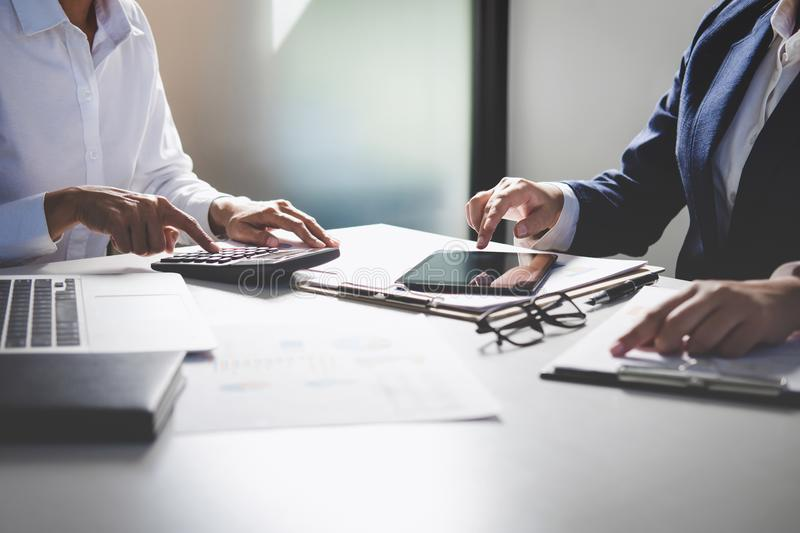 Teamwork of business colleagues consultation market growth on financial document graph report, professional occupation working royalty free stock photo