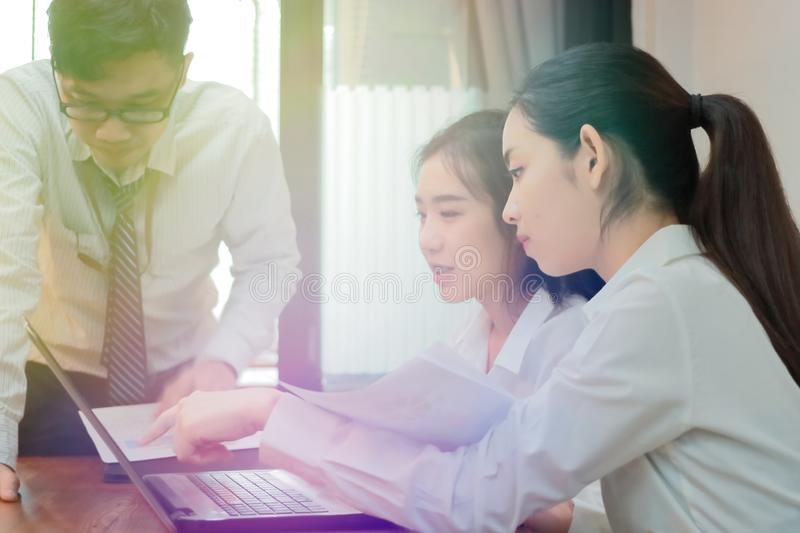 Teamwork business concept. Group of Asian people working with laptop together in modern office. Selective focus and shallow depth. Of field royalty free stock photos