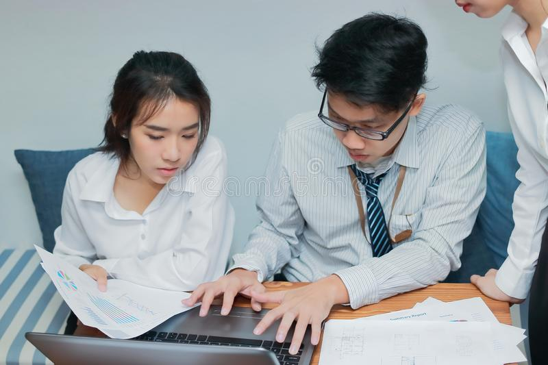 Teamwork business concept. Group of Asian people working with laptop together in modern office. Selective focus and shallow depth. Of field stock image