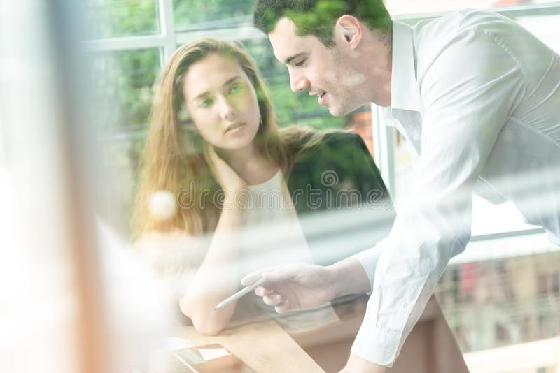 Teamwork business concept .Start up business people in modern office, working together having success. Multiethnic start-up royalty free stock image